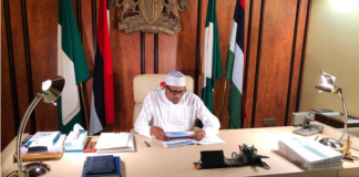Presidency dismisses rumors of President Buhari's whereabouts, posts photo of him in his office